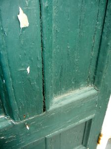 Layers of paint were stripped from the front door; dark green, light blue, medium blue/gray, mint green, light yellow and white