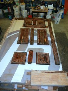 Individual pieces laid out on the workbench
